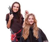 Studio shot of hairdresser doing curly hair — Stock Photo