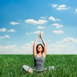 Beautiful young woman meditating at the meadow — Stock Photo #10838013