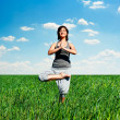 Stock Photo: Young woman practicing yoga