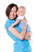 Smiling mother holding her baby — Stock Photo