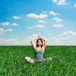 Sunny day and woman meditating — Stock Photo