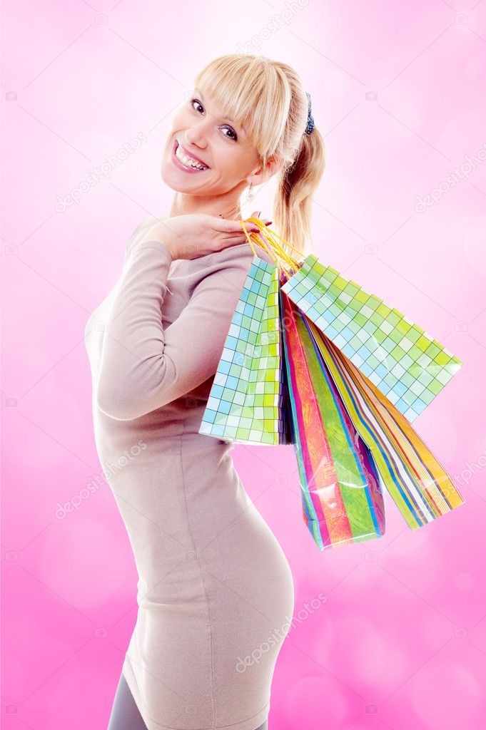 Beautiful happy woman posing with shopping bags — Stock Photo #11343023