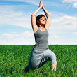 Happy woman meditating at the field — Stock Photo