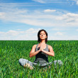 Woman meditating on green meadow — Stock Photo #11466040