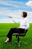 Beautiful businesswoman sitting on recliner — Stock Photo