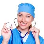 Smiling female doctor holding stethoscope — Stock Photo
