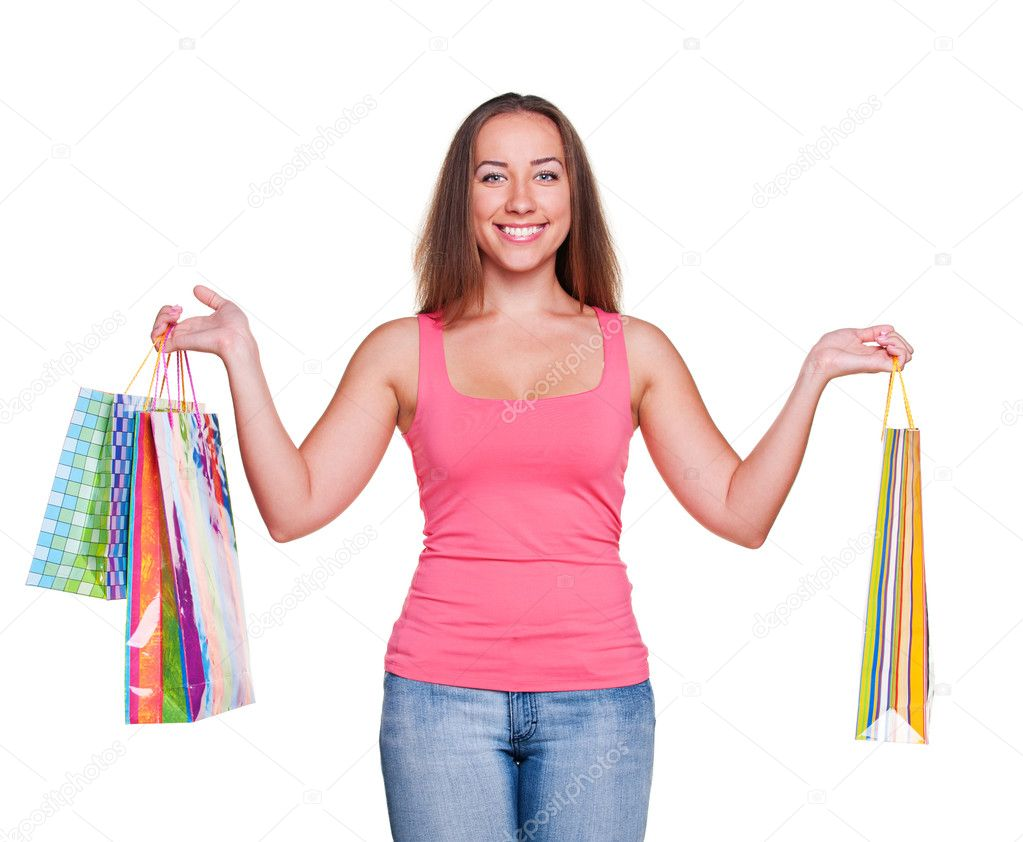 Attractive woman holding shopping bags. isolated on white background — Stock Photo #11589392