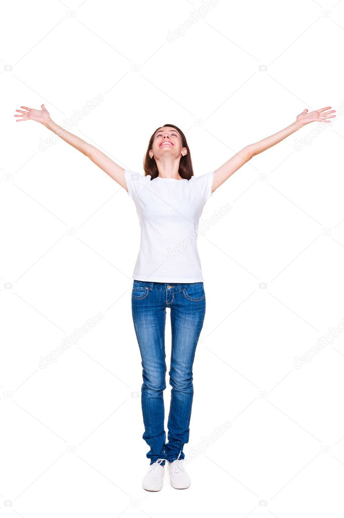 Happy young woman standing with raised up hands. full length portrait over white background — Stock Photo #11656788