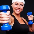 Healthy young woman with blue dumbbells - Stok fotoğraf