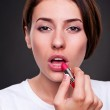 Woman painting her lips — Stock Photo #11857776