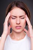 Young woman have a headache — Stock Photo