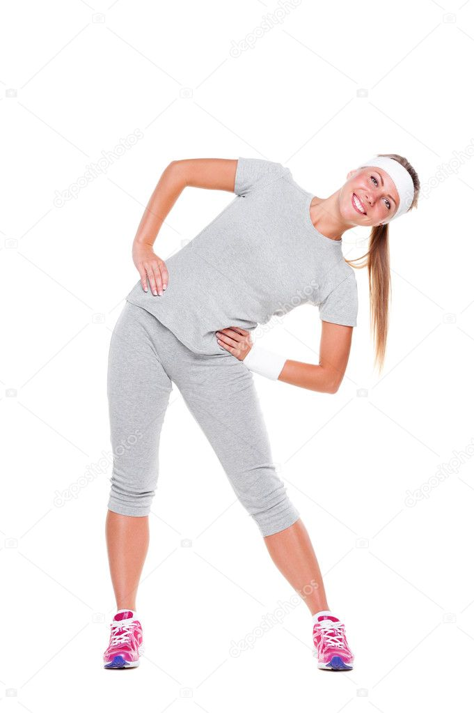 Smiley woman training in grey sportswear over white background — Stock Photo #11857759