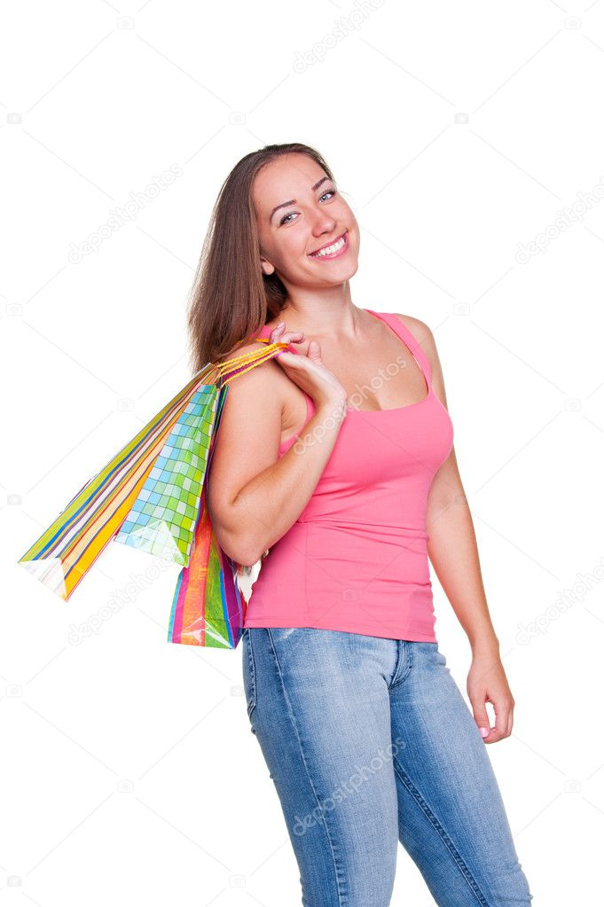 Happy girl holding shopping bags and smiling over white background — Stock Photo #12050779