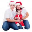Christmas family sitting on floor — Stock Photo