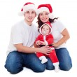 Stock Photo: Christmas family sitting on floor