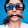 Frightened woman in 3d glasses — Stock Photo