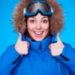Lively skier over blue background — Stock Photo