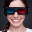 Smiley woman watching 3d film — Stock Photo #12325802