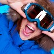 Royalty-Free Stock Photo: Woman in ski glasses and winter coat
