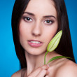 Woman with flower bud — Stock Photo