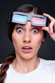 Startled woman in 3d glasses — Stock Photo
