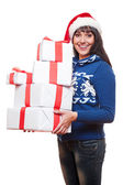 Woman holding christmas gifts — Stock Photo