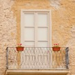Stock Photo: Old flowery balcony in Italy