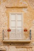 Old flowery balcony in Italy — Stock Photo