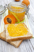 Homemade jam on a slice of toast — Stock Photo