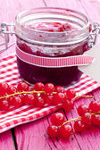 Jar of redcurrants jam — Stock Photo