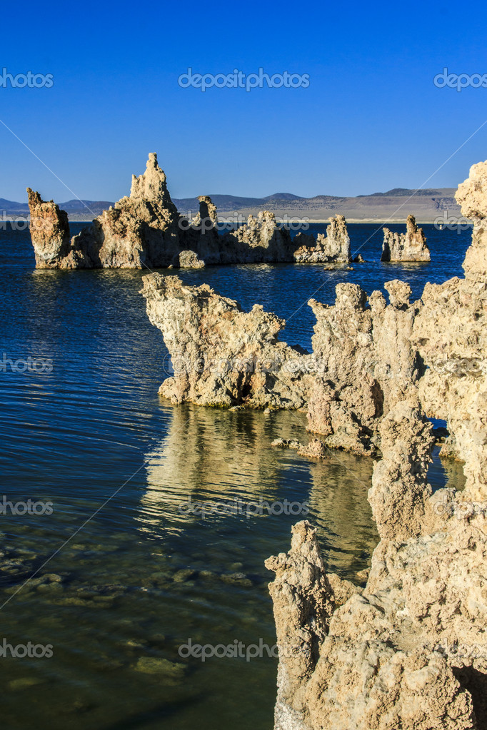 Tufa tower rock formations in Mono Lake are calcium-carbonate spires and knobs formed by interaction of freshwater springs and alkaline lake water. — Stock Photo #12396833