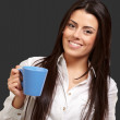 Young girl holding cup over black background — Stock Photo #10777595