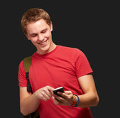 Portrait of young man touching mobile screen over black backgrou — Stok fotoğraf