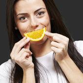 Woman with an orange smile — Stock Photo