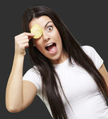 Woman with a potatoe chip — Stock Photo