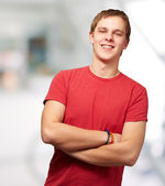 Portrait of young man smiling indoor — Stock Photo