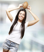 Woman holding a coconut — Stock Photo