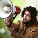 Man holding megaphone — Stock Photo #11477276