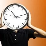 Man holding clock — Stock Photo #11580437