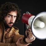 Man holding megaphone — Stock Photo #11581378