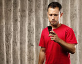 Young man with mobile phone — Stock Photo