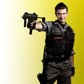 Young armed soldier — Stock Photo