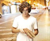 Man holding books — Stock Photo