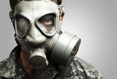 Soldier with gas mask — Stock Photo