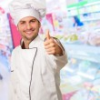 Stock Photo: Male Chef Keeping Thumb Up