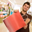 Foto de Stock  : Man Holding Shopping Bag