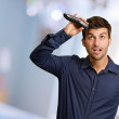 Portrait Of A Young Man Cutting His Hair — Stock Photo