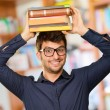 Stock Photo: Young Man With Books