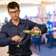 Young Man Pouring Champagne   — Stock Photo