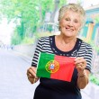 Portrait Of A Elderly Woman Holding Flag — Stockfoto